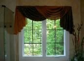 Simple but dramatic draped bathroom window treatment