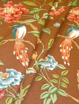 Draped curtain image of Hand printed Floral and Birds home decor fabric Blair in color Brown