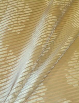 Draped curtain image of Stripe and Medallion Sheer Drapery Fabric, alternating see-thru and satin-like horizontal stripes