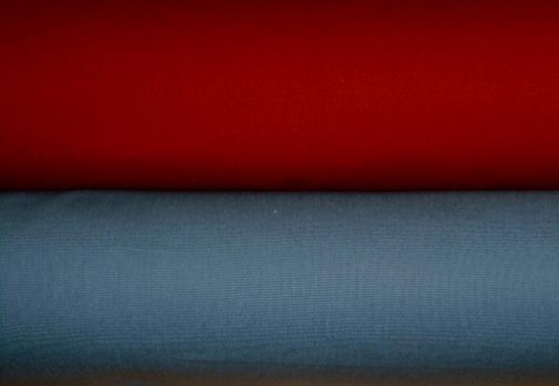 Rolls of Cotton Solid Plain Decorating Fabrics pattern Wrangler, colors Aegean Off Color and Paprika Off Color