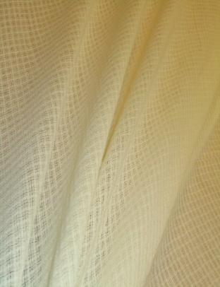 Draped curtain image of Beacon Hill worsted wool British made Fina casement in Cream