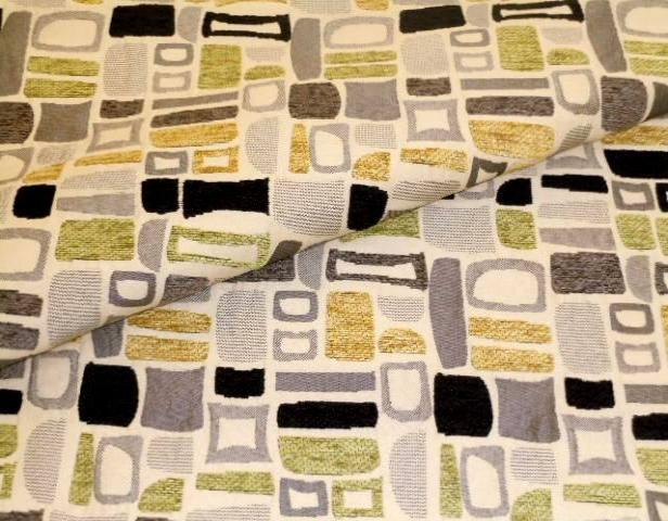 Closeup folded image of Contemporary Upholstery Fabric Pattern Geiger Color Oasis with geometric chenille accents, gray, yellow and green on cream