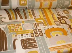 Angled image of Mesoamerican Mexican design look, Cotton, in Colors golden yellow, tangerine, brown, pale teal and putty grey on a tan background