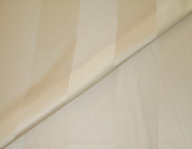 Closeup folded image of Pattern Lyon in color Ivory, Drapery weight Fabric tone on tone stripe pattern up the roll polyester cotton blend