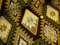 Aztec inspired diamond design in browns, tan, green and gray