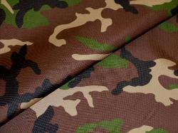 closeup of outdoor and marine canvas in camouflage, colors black, tan, green and dark brown