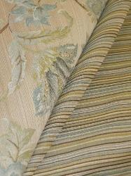 Draped curtain image of Pattern Deville Railroaded Stripe and Pattern Greenbrier woven jacquard floral, for furniture upholstering and other interior decorating