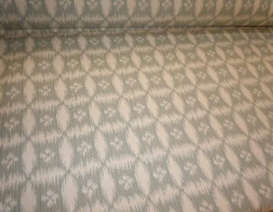 Angled image of medium weight woven jacquard cotton home decorating fabric, Pattern Sumba Color Chambray