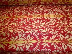 Pattern Tantalor color Paprika railroaded woven floral medallion damask design on cutting table