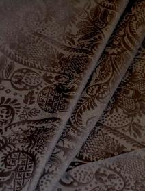 Draped curtain image of textured paisley pattern decorator fabric
