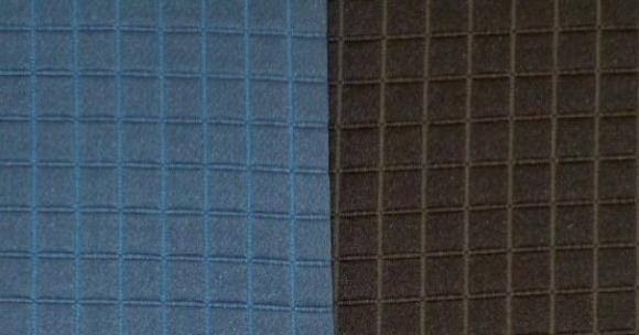 Swatches of this classic textured small square diamond pattern upholstery fabric in colors Indigo (blue) Charcoal (black)